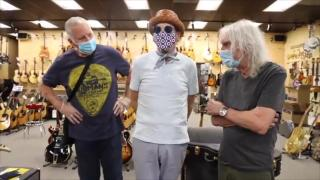 Elliot Easton & Albert Lee signs guitar for Jason Becker